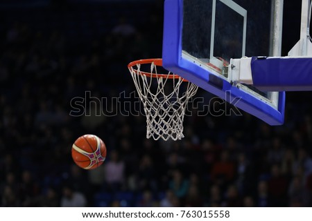 Basketball ball, board and net on black background sports hall