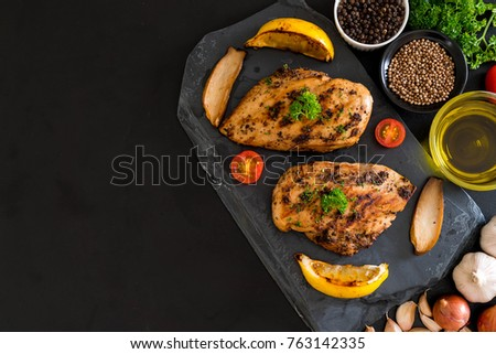 Grilled chicken fillets on slate plate #763142335