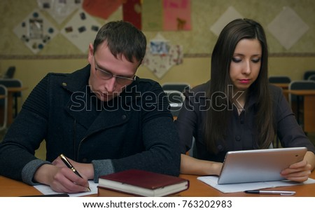 Pass exam. Lesson. Lecture. Two executive students sits at school desk table and studies. Education concept. #763202983