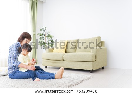 Child using smartphone with grandmother #763209478