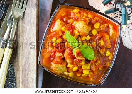 Mexican chicken. Chicken breasts in tomato sauce with sweet corn and rice.  #763247767