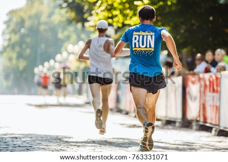 Team runners in the park Royalty-Free Stock Photo #763331071
