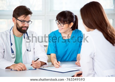 Group of doctors in the clinic discuss the diagnosis of the patient #763349593