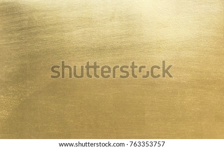 Shiny yellow leaf gold foil texture background Royalty-Free Stock Photo #763353757