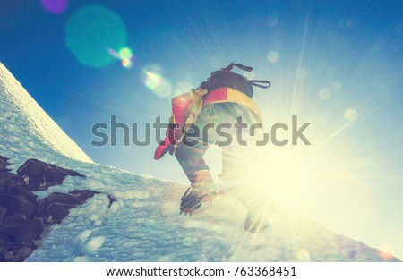 Group of climbers reaches the top of mountain peak. Climbing and mountaineering sport. Nepal mountains. Royalty-Free Stock Photo #763368451