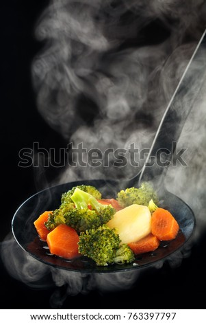Steamed vegetables and steam. #763397797