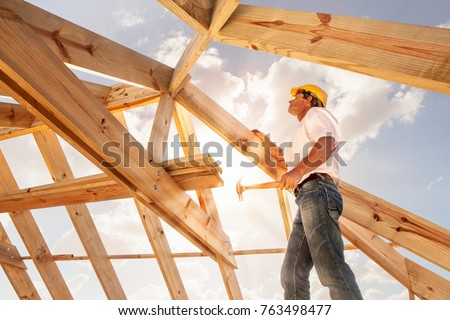 worker roofer builder working on roof structure on construction site #763498477