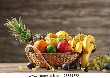 Bowl with delicious ripe fruits on table #763518721