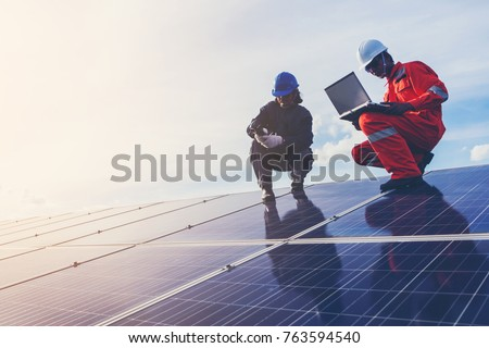 engineer working on checking equipment in solar power plant   Royalty-Free Stock Photo #763594540