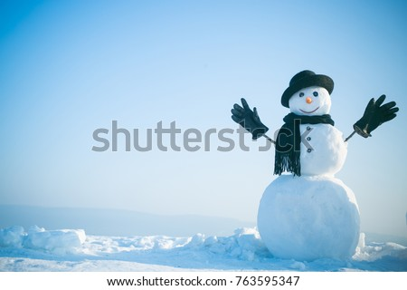 Snowman gentleman in winter black hat, scarf and gloves. New year snowman spy agent. Christmas and winter fashion. Happy holiday celebration. Xmas or christmas party, copy space Royalty-Free Stock Photo #763595347