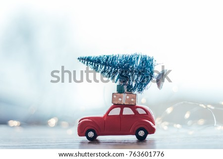 Toy car with Christmas gifts and  tree