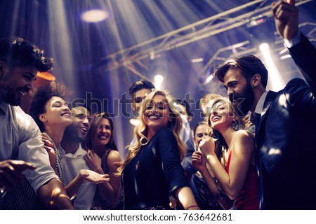 Shot of a young woman dancing with friends #763642681
