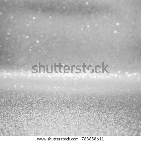 silver and white abstract glitter background with bokeh defocused lights christmas #763658611