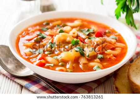 Italian minestrone soup on white wooden background. Selective focus. #763813261