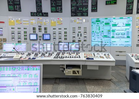 The central control room of nuclear power plant. Fragment of nuclear reactor control panel. Royalty-Free Stock Photo #763830409