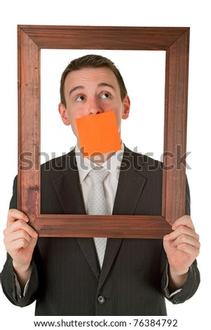 Friendly businessman with wooden frame isolated on white background