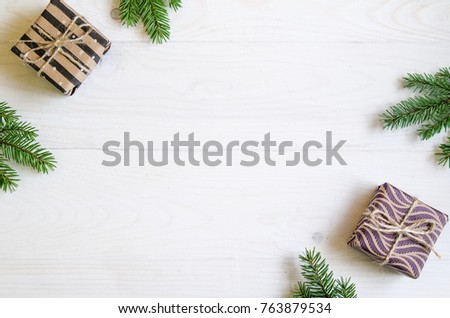 Christmas still life with gifts on a white wooden background with a Christmas tree. New Year gifts #763879534