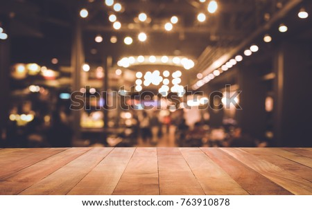 Wood table top (Bar) with blur light bokeh in dark night cafe,restaurant background .Lifestyle and celebration concepts ideas Royalty-Free Stock Photo #763910878