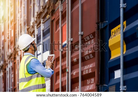 Foreman control loading Containers box from Cargo freight ship for import export, foreman control Industrial Container Cargo freight ship #764004589