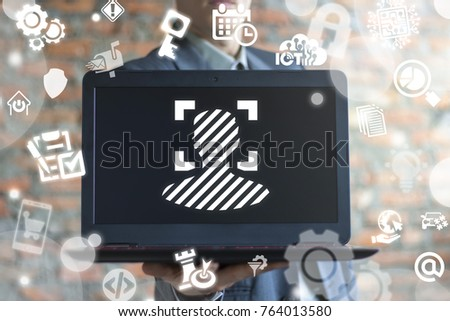 Businessman using virtual interface offers laptop with face identification icon (man fingerprint person scanning). Facial Detection. Personal Access Security Computing Diital Data concept.