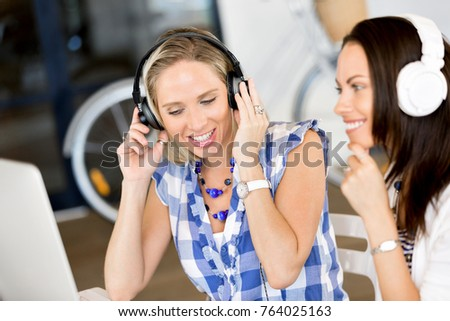 Young woman with headphones indoors #764025163