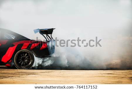Sport car wheel drifting. Blurred of image diffusion race drift car with lots of smoke from burning tires on speed track. Sport concept,Drifting car concept #764117152