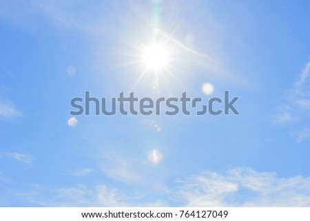 Sun lighting with blue sky background. #764127049