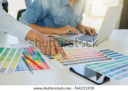 Graphic design and color swatches and pens on a desk. Architectural drawing with work tools and accessories #764215930