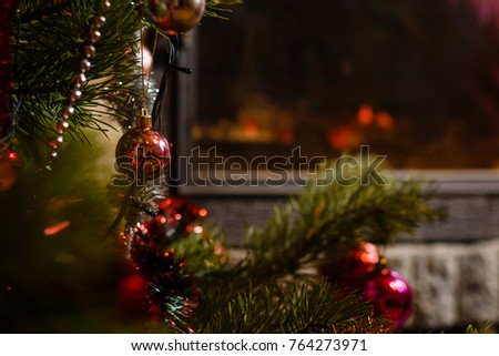 Christmas tree near fireplace in room #764273971