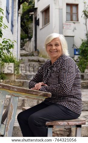 An elderly woman on the street.Portrait of an elderly woman #764321056