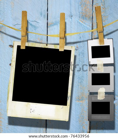Slides and an instant picture hanging on a rope, free space for pix