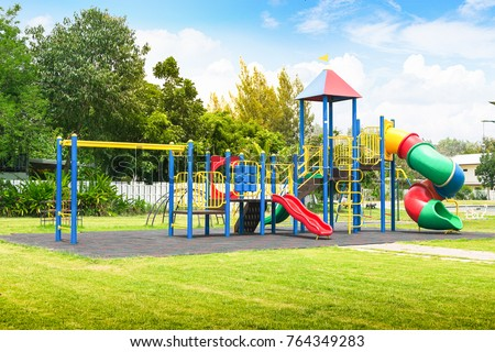 Colorful playground on yard in the park. Royalty-Free Stock Photo #764349283