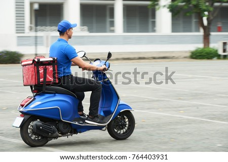 Courier on the scooter delivering food #764403931