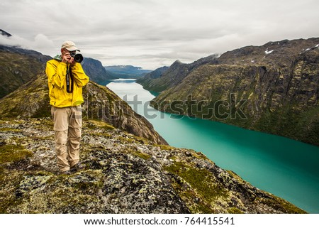 Norway August 10 2012. A photographer in Jotunheimen, Norway #764415541