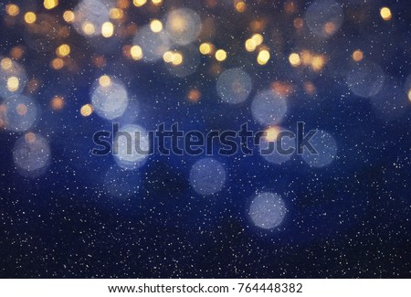 Blurred bokeh light background, Christmas and New Year holidays background Royalty-Free Stock Photo #764448382