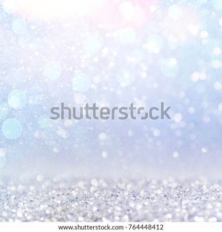 Blurred bokeh light background, Christmas and New Year holidays background #764448412