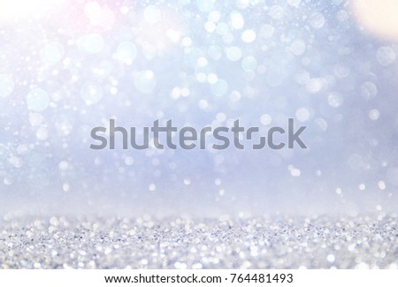 Blurred bokeh light background, Christmas and New Year holidays background #764481493