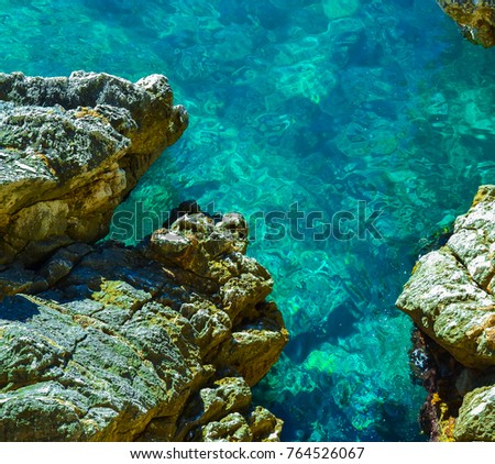 Nice view of the sea. Calm clear sea. Large stones. The Adriatic. Montenegro #764526067