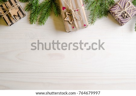 Christmas presents with a Christmas tree on a white wooden background. new Year gifts #764679997