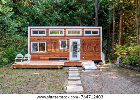 Small wooden cabin house. Exterior design. Royalty-Free Stock Photo #764712403