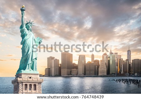 The Statue of Liberty with Lower Manhattan background in the evening at sunset, Landmarks of New York City, USA Royalty-Free Stock Photo #764748439