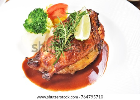 Half of appetizing roasted juicy chicken with lemon slices and  vegetables  #764795710