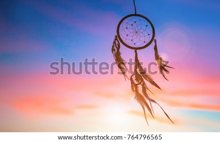 Beautiful native american dream catcher against sunset background