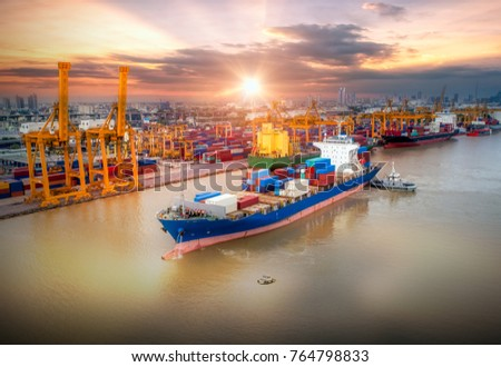Logistics and transportation of Container Cargo ship and Cargo plane with working crane bridge in shipyard at sunrise, logistic import export and transport industry background #764798833