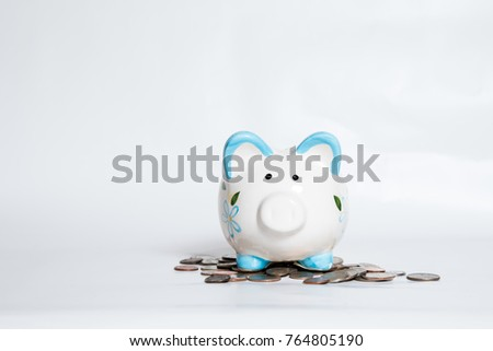 Piggy Bank with pile of change #764805190