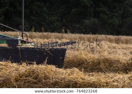 tractor haying straw on summer corn field in south germany countryside #764823268