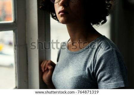 Young Caucasian girl with eyeglasses #764871319