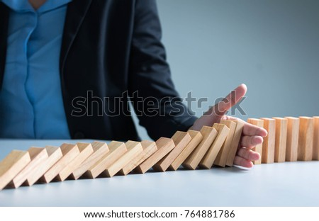Risk management Businesswoman stop domino effect. leadership has solution for problem.  #764881786