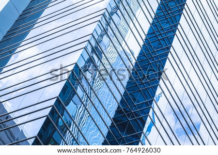 Modern business architecture, abstract fragment, walls made of glass and steel with reflections of blue sky #764926030