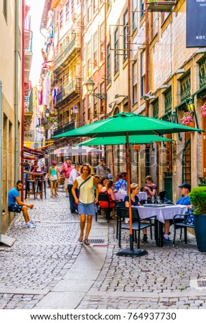PORTO, PORTUGAL, SEPTEMBER 6, 2016: View of a narrow street in the historical center of Porto, Portugal. #764937730